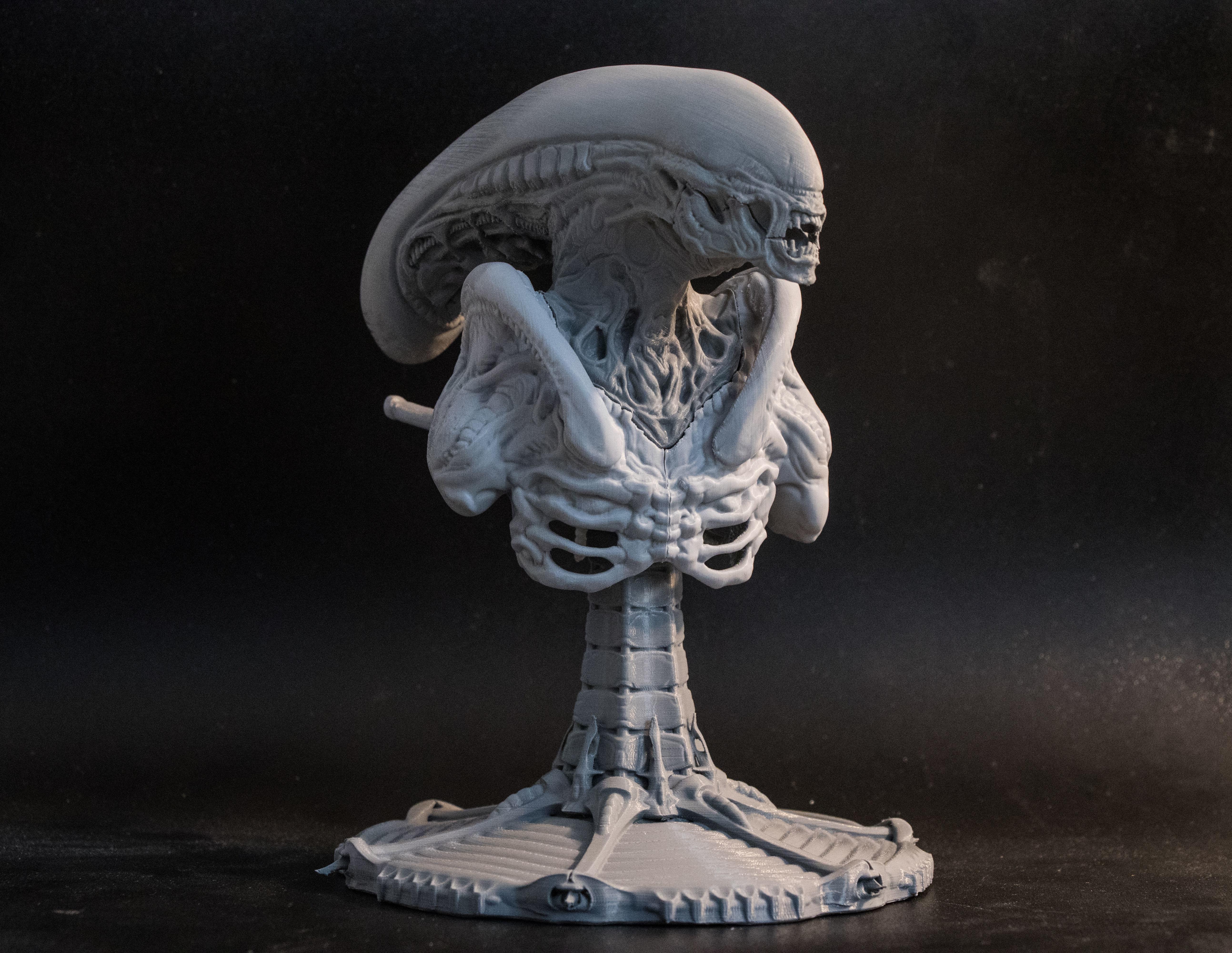 Alien bust statue