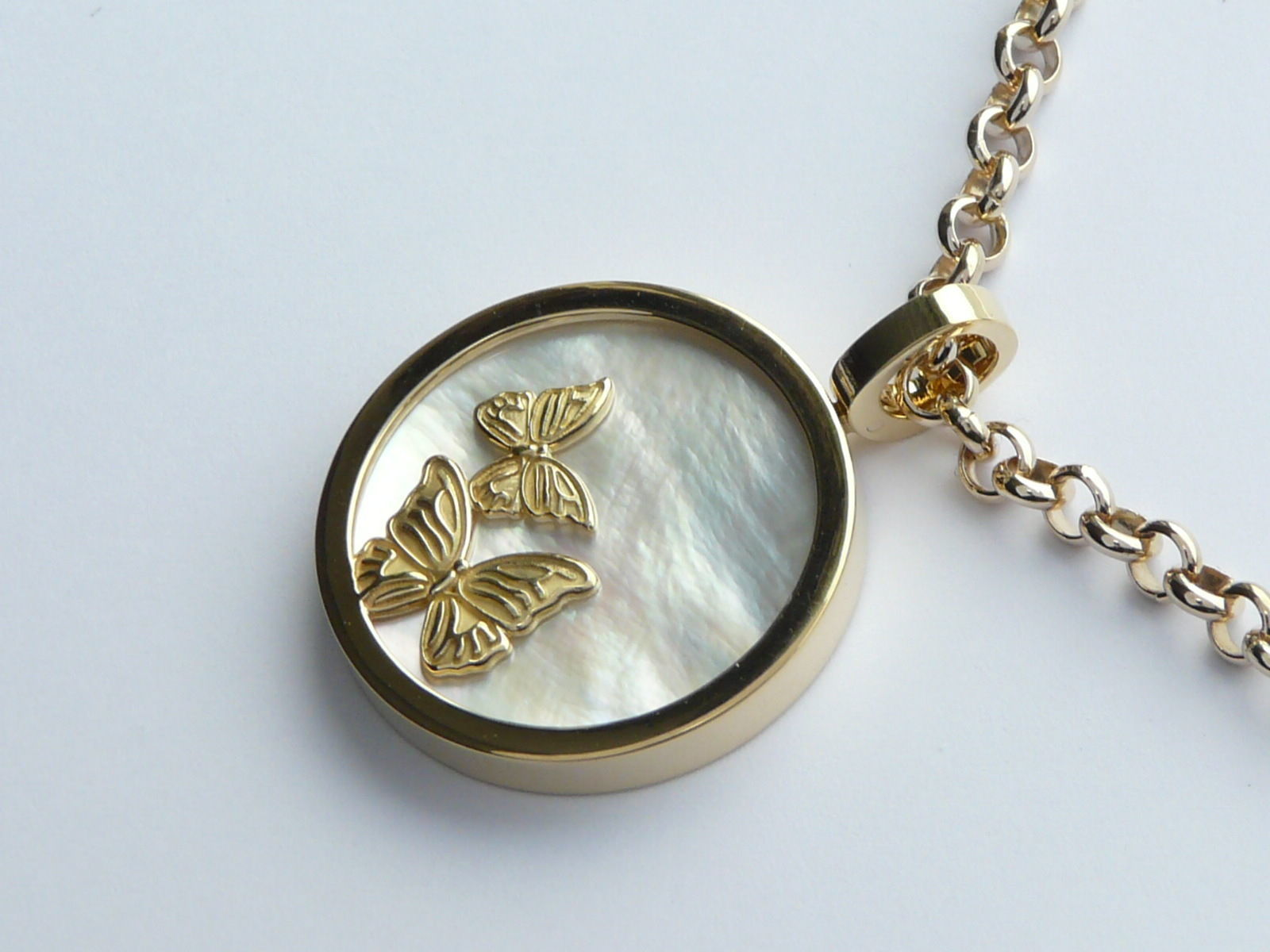 DOUBLE-SIDED PENDANT