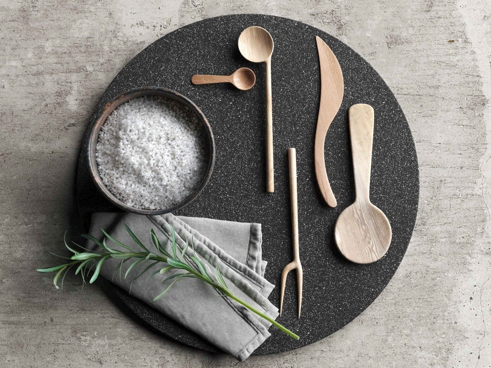 Lava Plate with Wooden Tableware Napkin and Rosemary