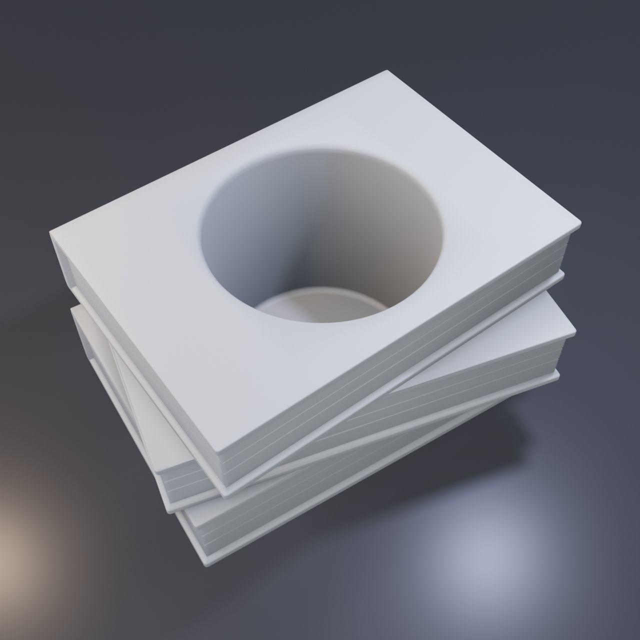 Three books with a hole